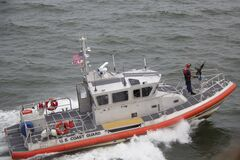 White Orange U.S. Coast Guard Boat on the Sea Royalty Free Stock Photography