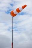 White and orange wind sleeve Stock Photos