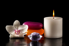 White orchid flower, candle, soap and sea salt for spa procedure Stock Image