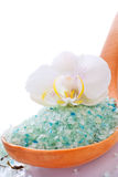 White orchid flower with  mineral bath salt. White orchid flower with blue mineral bath salt Royalty Free Stock Photo