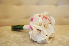 White orchids and pink roses wedding bouquet. Wedding idea for the bride. Beautiful natural flowers bouquet to fit the style of the bride. Specialized florist stock image