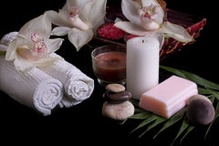 White orchids, spa products in wooden box Stock Photography