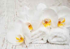 White orchids and towels Royalty Free Stock Images