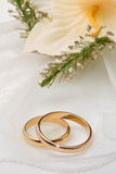 White orchids and wedding rings Stock Photography