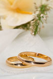 White orchids and wedding rings Royalty Free Stock Photo