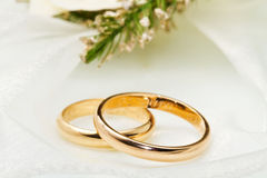 White orchids and wedding rings Stock Photos