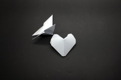 White origami butterfly and heart shape paper Stock Photo