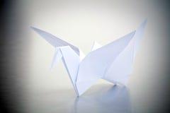 White Origami Crane. On Grey Metal Background stock photography