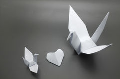 White origami crane and heart between, bird paper Royalty Free Stock Photography