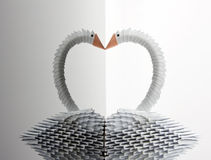 White origami swan with reflection Stock Image
