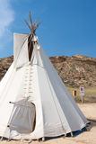 White original American teepee with blue sky in the background Royalty Free Stock Photo