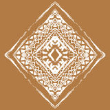 White ornament on brown background in bohemian style. Native American design element painted with grunge brushes.  Stock Photography