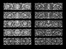 White ornaments on black Royalty Free Stock Photos
