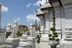 White ornate towers of Temple of the Emerald Buddha Wat Phra Kaew, Bangkok Royalty Free Stock Photos
