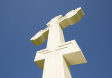 White orthodox christian cross on blue sky background. Royalty Free Stock Photos