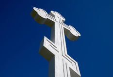 White orthodox christian cross on blue sky background. Royalty Free Stock Photography