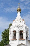 White orthodox church against blue sky with white clouds Royalty Free Stock Image