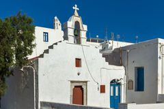White orthodox church and belfry in Mykonos, Greece Royalty Free Stock Image
