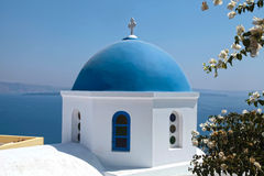 White orthodox church with blue dome, Santorini island, Greece. White orthodox church with blue dome with sea view in the village of Oia, Santorini island Stock Photos