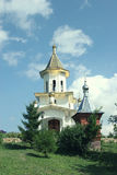 White orthodox church with domes amidst summer meadow Royalty Free Stock Images