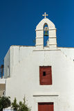 White orthodox church and small bell tower in Mykonos, Cyclades, Greece Stock Image
