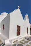 White orthodox church and small bell tower in Mykonos, Cyclades, Greece Royalty Free Stock Images