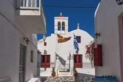 White orthodox church and small bell tower in Mykonos, Greece Stock Photo