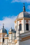 White orthodox church towers against the blue sky. White orthodox church towers against the blue sky and white clouds Royalty Free Stock Image
