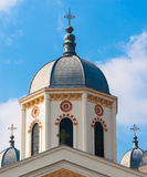 White orthodox church towers against the blue sky. White orthodox church towers against the blue sky and white clouds Stock Image