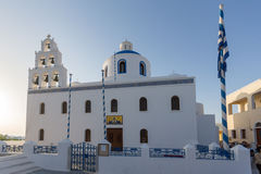 White Orthodox church in town of Oia, Santorini island, Thira, Cyclades Royalty Free Stock Image