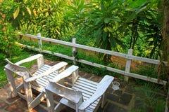 White Outdoor furniture in the garden Royalty Free Stock Photos