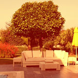 White outdoor furniture in the garden Royalty Free Stock Photography