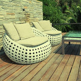 White outdoor furniture on wood resort terrace Royalty Free Stock Image