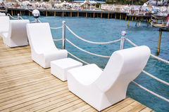 White  outdoor lounge sea sunbeds Stock Photo