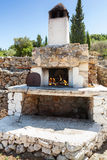 White outdoor stone oven with burning fire Stock Photography