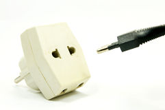 White outlet and black plug. On white background Royalty Free Stock Photos