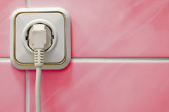 White outlet on a red wall Stock Photo