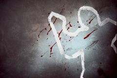 White outline of victim at crime scene royalty free stock photography