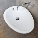 White Oval Basin. In Exposed Concrete Wall Bathroom Stock Image