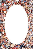 White oval photo frame coastal stonnies background Stock Photo