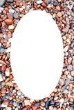 White oval photo frame coastal stonnies background Stock Photo