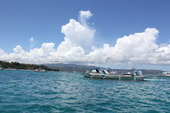 White clouds over the blues. Cottony white clouds over clear blue water in Boracay, Philippines stock photo