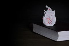 White Owl Statuette  Nightlight With Red Lights On Old Book Stock Images