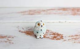 White owl on white wooden background. royalty free stock image