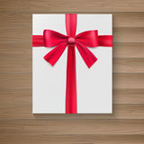 White package with a large red bow. Stock Photography