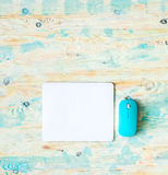 White pad with blue mouse Stock Photos