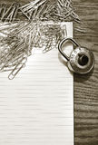 White pad with paper clips, school lock Royalty Free Stock Photos