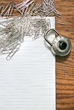 White pad with paper clips, school lock Royalty Free Stock Photography