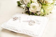 White Pad with Wedding Rings Stock Photography