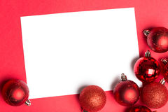 White page with red christmas baubles Stock Images